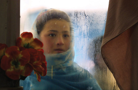 Switan, 10, looked into the window of a Herat restaurant. Kabul, Afghanistan, 2002.