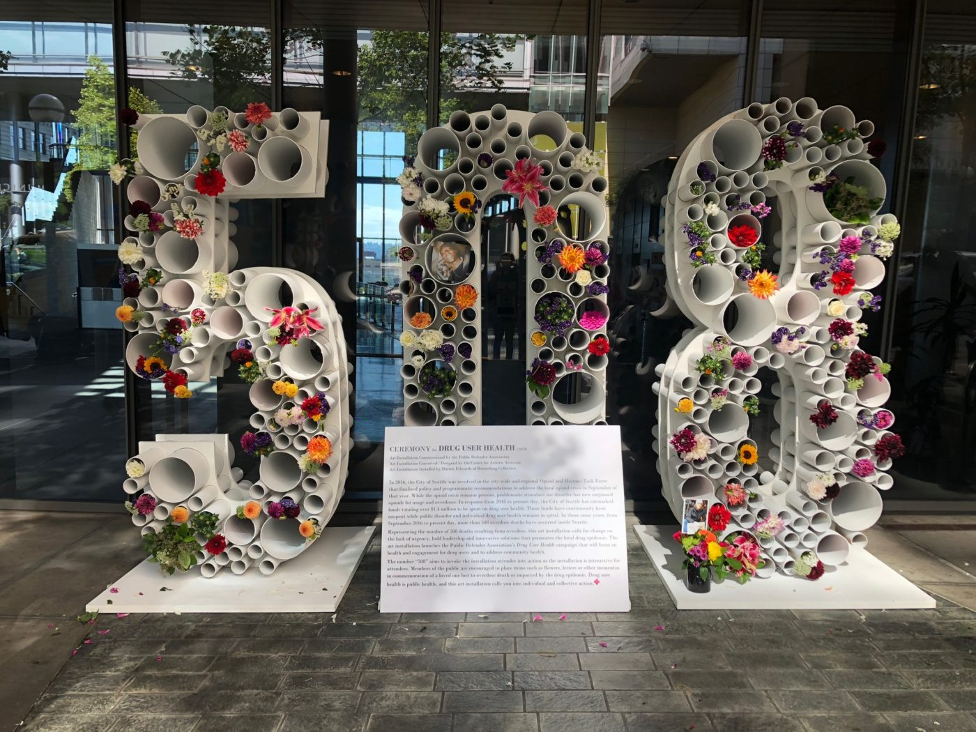 """8 foot tall numbers that read """"508"""". In the face of the numbers are flowers."""